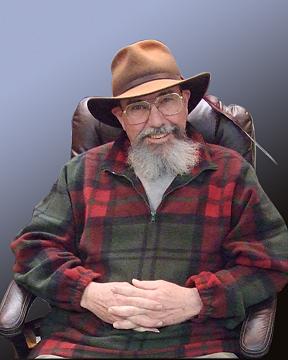 Photo of Michael Faris wearing a hat