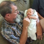 Grandpa holds Chase 3 days old